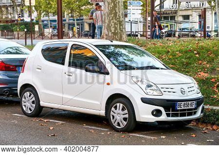 Versailles, France - September 15, 2019: White Compact Car Nissan Pixo In The City Street.
