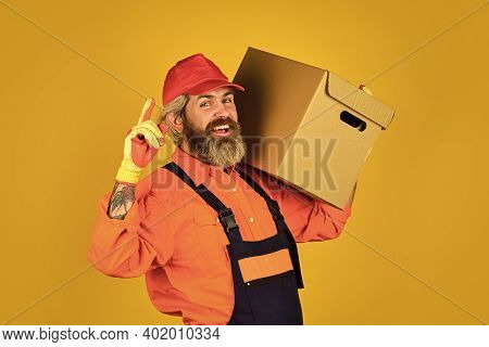 Its Always Saturday. Unpacking Moving Boxes. New House At Moving Day. Man Builder In Boilersuit Hold