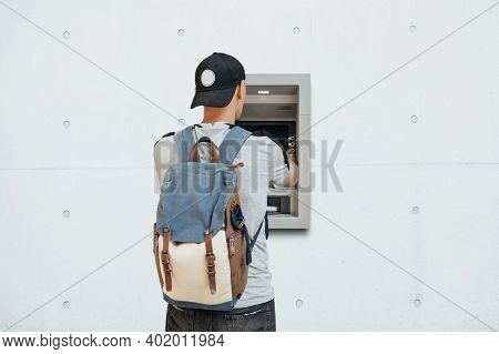 The Tourist Withdraws Money From The Atm For Further Travel. Finance, Credit Card, Withdrawal Of Mon