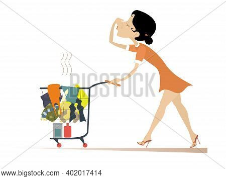 Woman With A Trolley Going To Wash Dirty Laundry. Young Woman Moves A Trolley With Dirty Laundry And