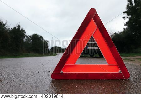 Red Triangle Of A Car On The Road. Car Warning Triangle. Car Breakdown In Bad Weather.