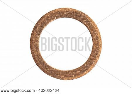 Macro Shot Small Copper Ring Isolated On White Background. Copper Washer Isolated Over White