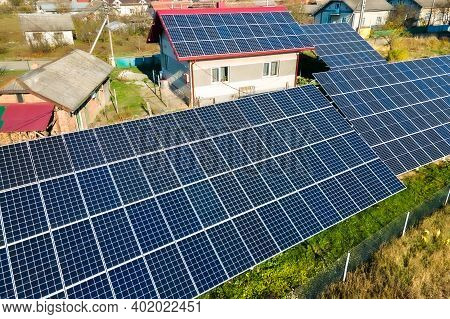 Private House With Ground Located Solar Photovoltaic Panels For Producing Clean Electricity. Autonom