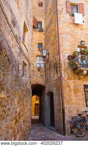 An Alleyway Through An Historic Stone Building In The Village Of Pienza In Siena Province, Tuscany,