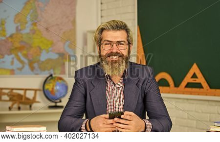 Back To School. Track Student Progress. Teaching Materials. Who Is Absent Today. Bearded Man Teacher
