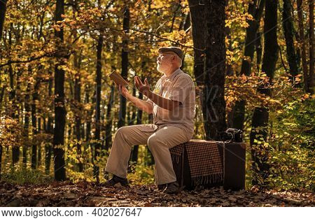 Happy Pensioner Relax On Autumn Nature. Retirement Travel And Hobbies. Ecology. Mature Man Hold Yell