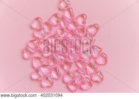 St. Valentine's Day Concept. Many Pink Hearts Isolated On Pink Pastel Background. Postcard Banner On