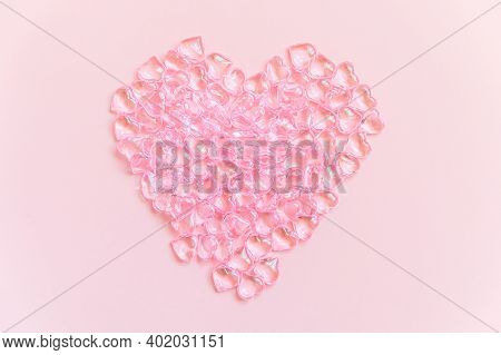 St. Valentine's Day Concept. Heart Shaped Objects Many Pink Hearts Isolated On Pink Pastel Backgroun