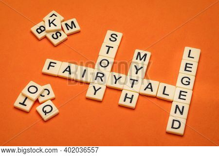 fairytale, story, myth and legend crossword in ivory letter tiles against textured handmade paper, storytelling, folklore and culure concept