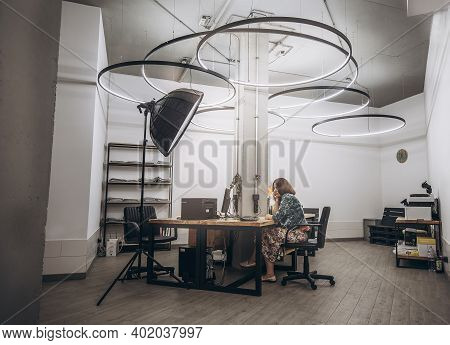 Woman Working At Desk In A Loft Office, Pensive Business Woman Sitting At Desk With Laptop And Worki
