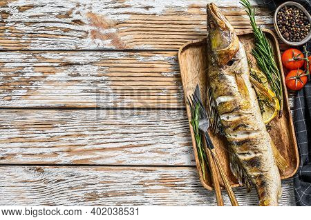 Baked Zander, Walleye Fish With Herbs And Lemon. White Wooden Background. Top View. Copy Space