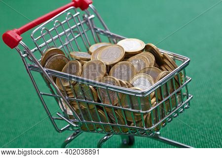 coins in the shopping basket,green background