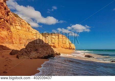 The famous beach of Praia dos Caneiros. Algarve.Portugal