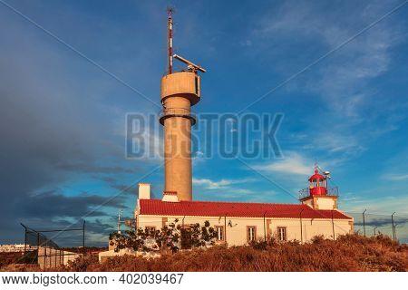 Lighthouse of Ponta do Altar on sunset sky background. Ferragudo, Lagoa, Algarve, Portugal