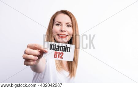 Female Hold A Card With Word Vitamin B12 On White