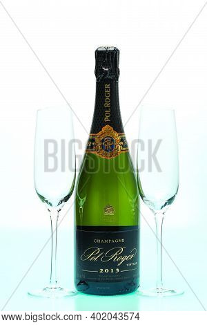 Beautiful View Champagne Bottle  Pol Roger, And  Two  Slim, Tall And Elegant Champagne Glasses On Wh