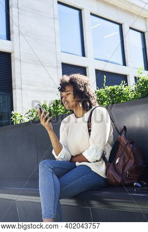 Young Pretty African Girl Posing Cheerful On City Background, Lifestyle Outdoor People Concept