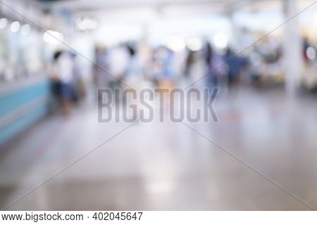 Abstract Blurred People Walk In Reception Corridor Background From Building Hallway For Corridor Bui