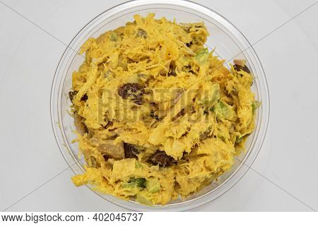 Overhead View Of Curried Chicken Salad Served By The Pound In Clear Plastic Container For Presentati