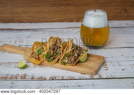Mexican Birria Tacos With Salsa And Cilantro With Glass Of Beer. Mexican Food
