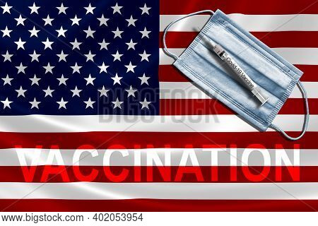 Covid-19 Vaccination In The United States Concept With Face Mask And Syringe Needle Vaccine On U.s.