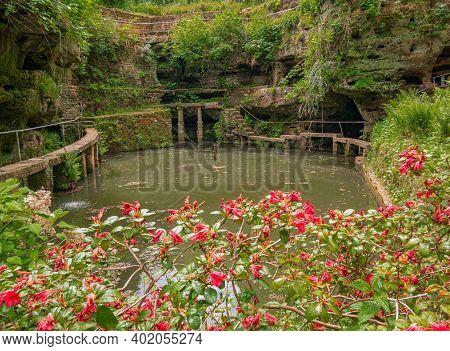 Footbridges Around The Artificial Rock Pond In Ernzen