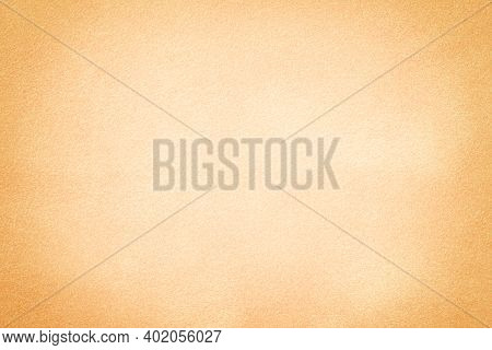 Light Beige Matte Background Of Suede Fabric With Vignette, Closeup. Velvet Texture Of Seamless Sand