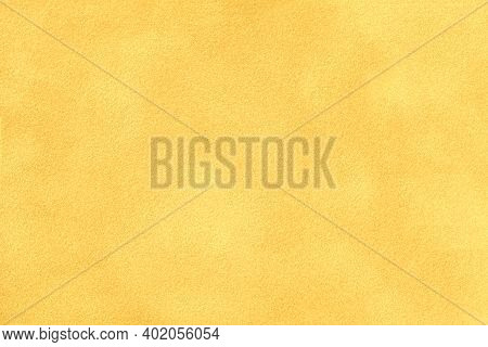 Light Yellow Matte Background Of Suede Fabric, Closeup. Velvet Texture Of Seamless Golden Textile, M
