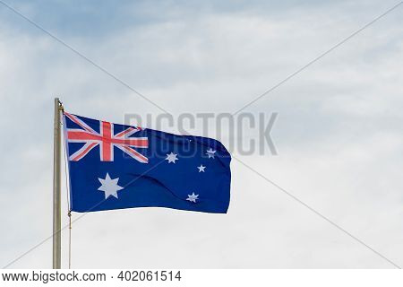 Australian Flag Australian Flag Blowing In The Wind. Australia Day Background With Copy Space