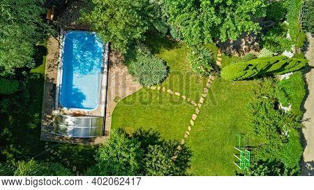 Swimming Pool In Beautiful Garden Aerial Top View
