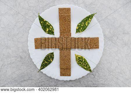 Til Sakri Or Tilgul A Winter Special Indian Sweet Dish Make Of White Sesame And Jaggery Melte In Cla