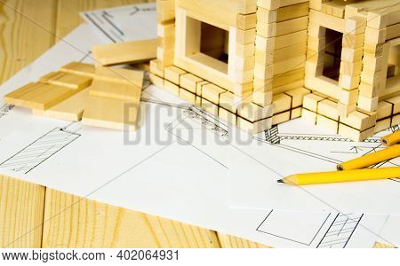 Building House. House Construction. Many Drawings For Building, Pencils And Small Wooden House On Wo