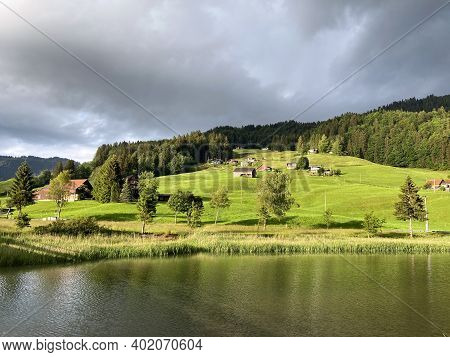 Traditional Architecture And Farmhouses With The Surrounding Pastures In The Sihltal Valley And By T