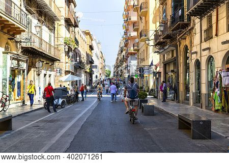 Tourists And Citizens Stroll In The Historic Center Of Palermo, In Via Maqueda