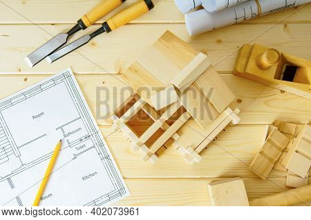 Construction House. Joiners Works. Drawings For Building, Small Wooden House And Working Tools On Wo