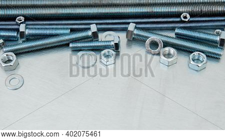Metal Tools. Metal Style. Metal Hairpins And Bolts On The Scratched Metal Background.