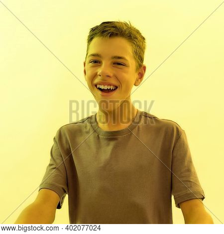 Close Up Portrait Of Joyful Teenaged Disabled Boy With Cerebral Palsy Smiling Away While Posing Isol