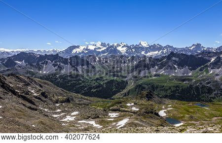 High Altitude Landscape In Alps With The View Of Barre Des Ecrins And La Meije In The Distance. In T
