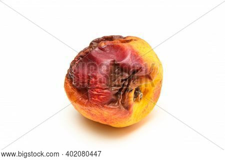 A Picture Of A Rotten Nectarine. The Shape Is Deformed And It Is Inedible. Isolated On White Backgro