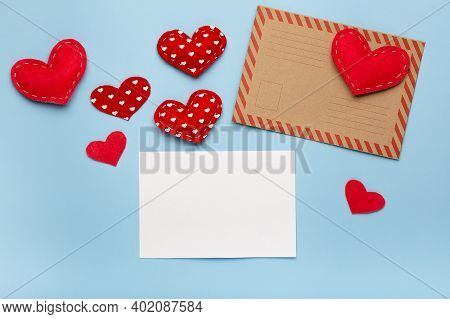 Valentines Day Love Letter Flat Lay. Envelope White Card And Hearts On Blue Background Copy Space To