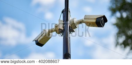 A Complex Of Outdoor Surveillance Camera On A Pole In The Park. A Complex Of Outdoor Surveillance Ca