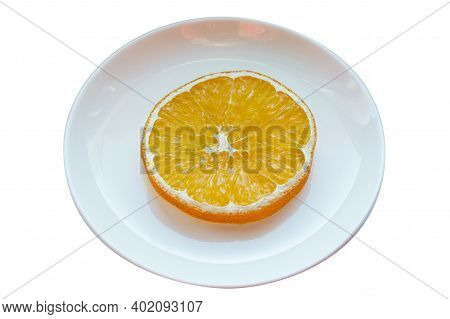 Plate With One Slice Of Dried Orange Isolated On White Background.