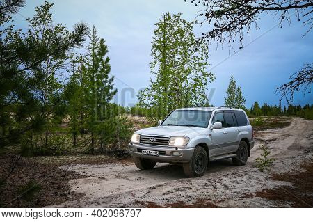 Novyy Urengoy, Russia - June 7, 2020: Grey Offroad Car Toyota Land Cruiser 100 In A Tundra.