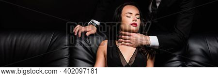 Man In Formal Wear Choking Sexy Woman Isolated On Black, Banner