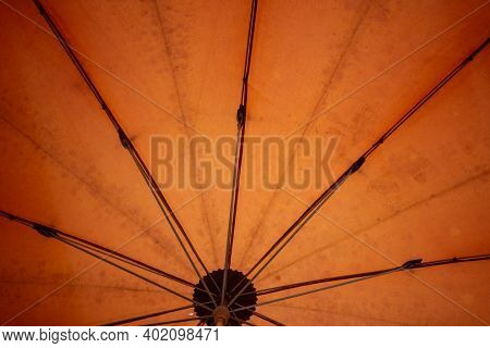 Orange vintage umbrella up close