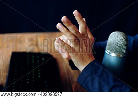 Gamer Shows Sings Of Victory. Crazy Gamer Streamer Show Gestures. Neon Keyboard On A Wooden Table. V