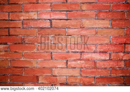 Weathered Stained Old Brick Wall With Cracks And Scratches. Brickwork Background With Stained Aged B