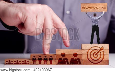 Business, Technology, Internet And Network Concept. Young Businessman Shows The Word:recommendation