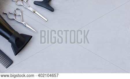 Hairdressing Tools In The Corner On A Light Gray Background With Space For Text. Hair Salon Accessor