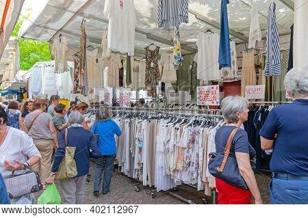Como, Italy - June 15, 2019: People Shopping At Clothing Stall Street Market Saturday In Como, Italy